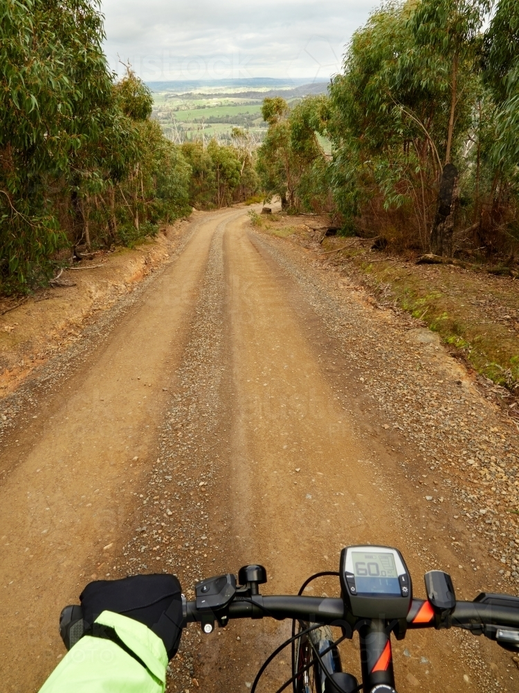 First Person View of Cyclist on Steep Gravel Road - Australian Stock Image