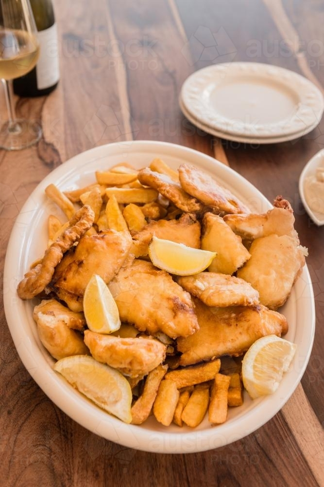 fish and chips in a large dish - Australian Stock Image