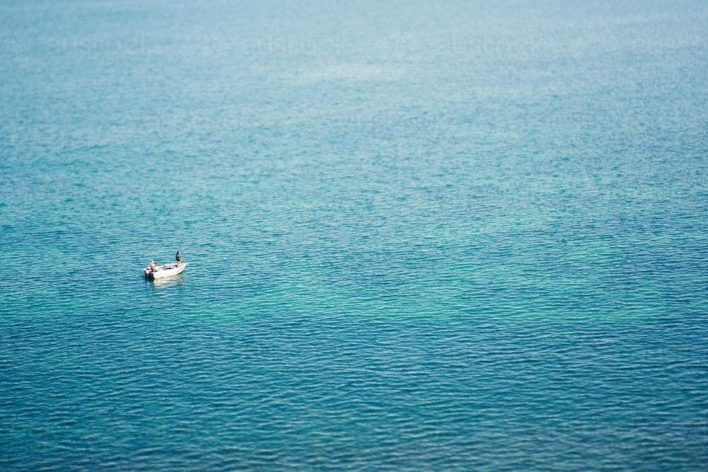 Fisherman on a fishing boat in the ocean - Australian Stock Image