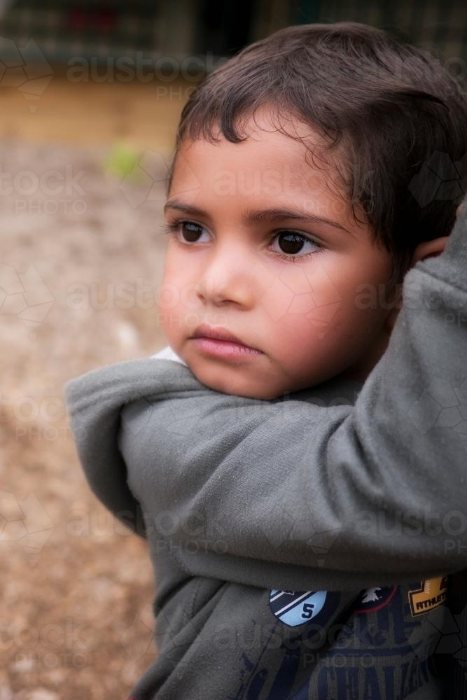 Five Year Old Aboriginal Boy with Serious Expression - Australian Stock Image