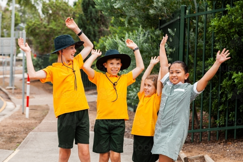 Four primary school children celebrating end of term - Australian Stock Image