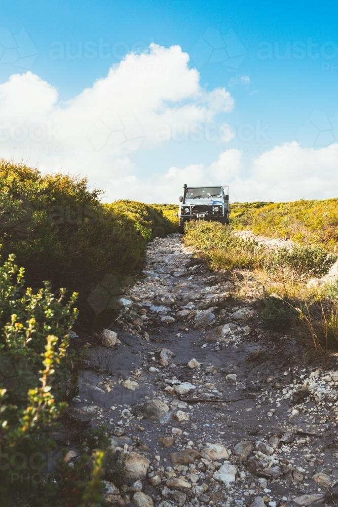 Four wheel drive truck on a rocky track - Australian Stock Image