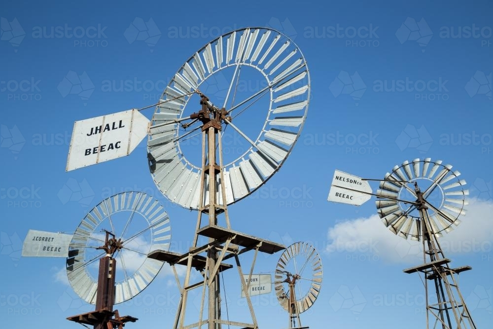 Four windmills against a blue sky - Australian Stock Image