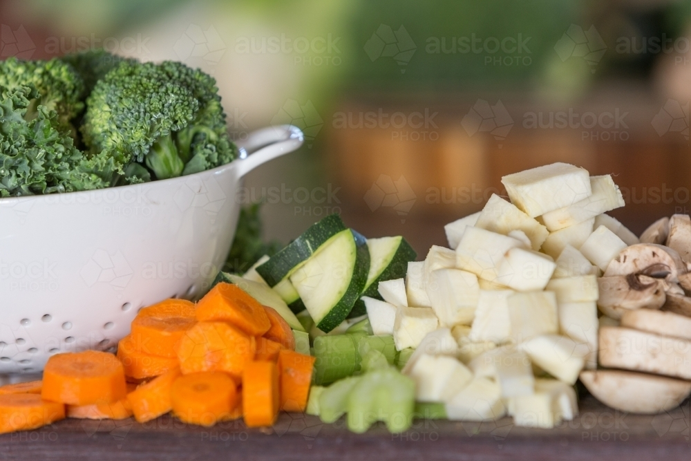 Fresh chopped vegetables on a cutting board - Australian Stock Image