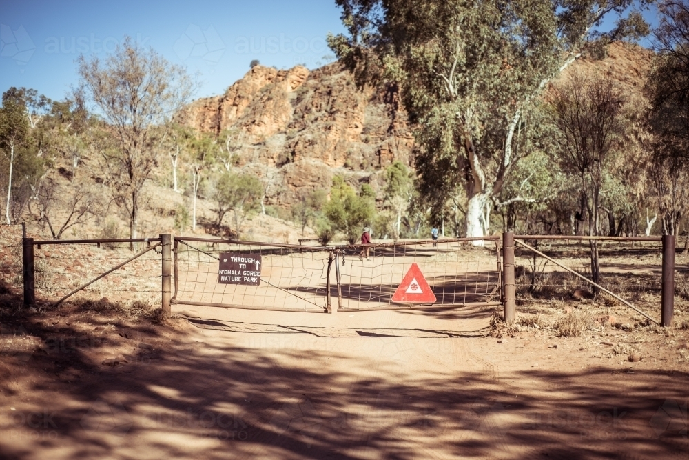 Gate to walking track in outback Northern Territory - Australian Stock Image