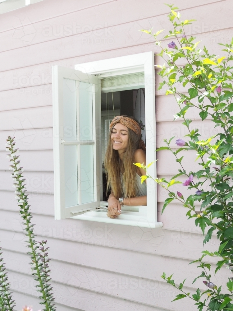 Girl looking out of window - Australian Stock Image