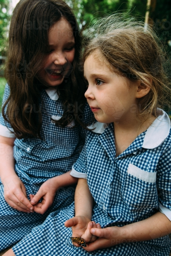 Girls sitting together in school uniform - Australian Stock Image