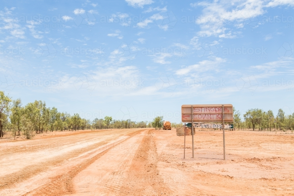Graffiti on road sign in the outback , Savannah Way - Australian Stock Image