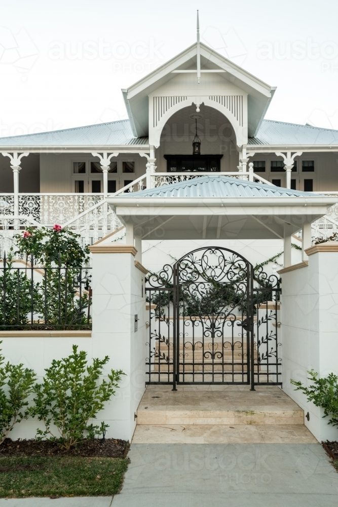 Grand Queenslander home with large front gate - Australian Stock Image