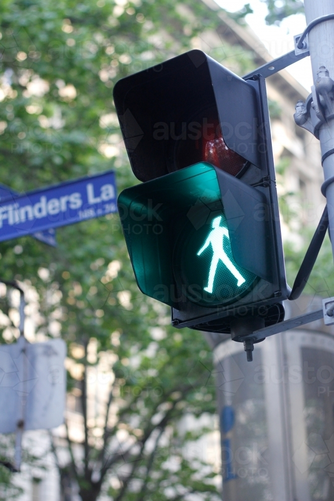 Green man on pedestrian crossing light - Australian Stock Image