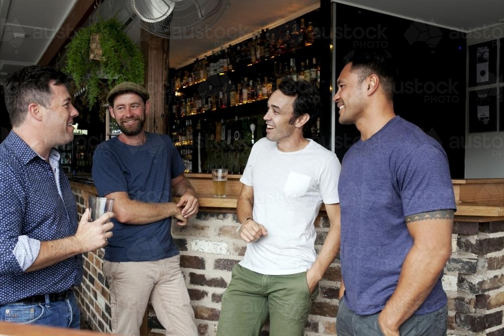 Group of mates having a drink at local craft beer bar - Australian Stock Image