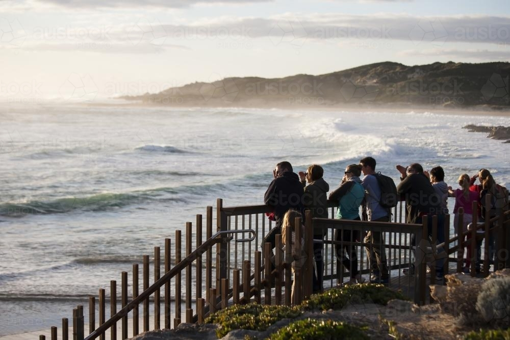 Group of people watching big swell at Margaret River - Australian Stock Image