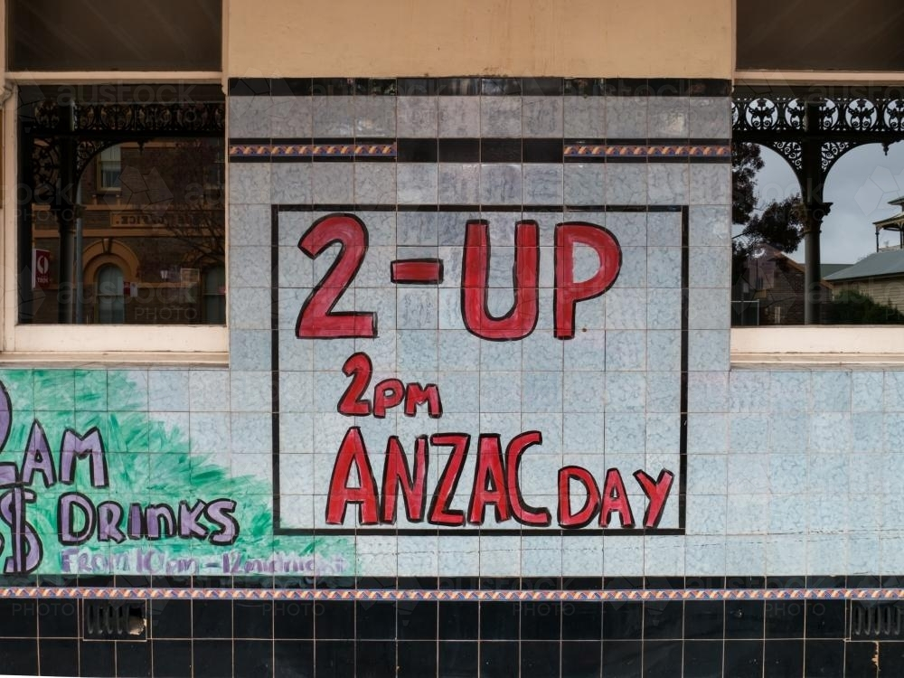 Handmade Two-Up sign on a tiled pub wall - Australian Stock Image