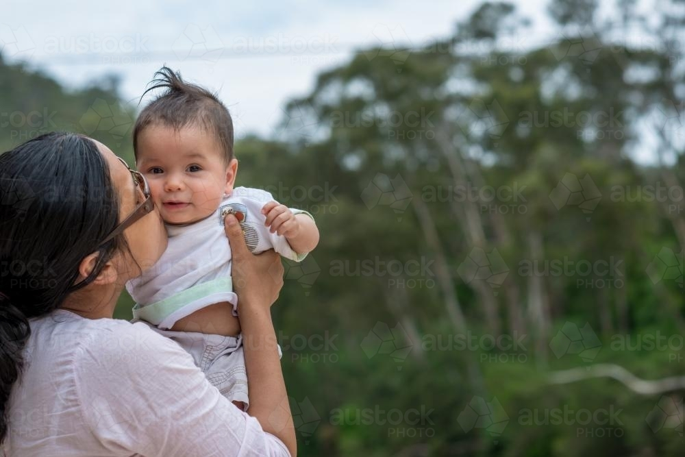 Happy Asian mum with her mixed race baby boy outside - Australian Stock  Image