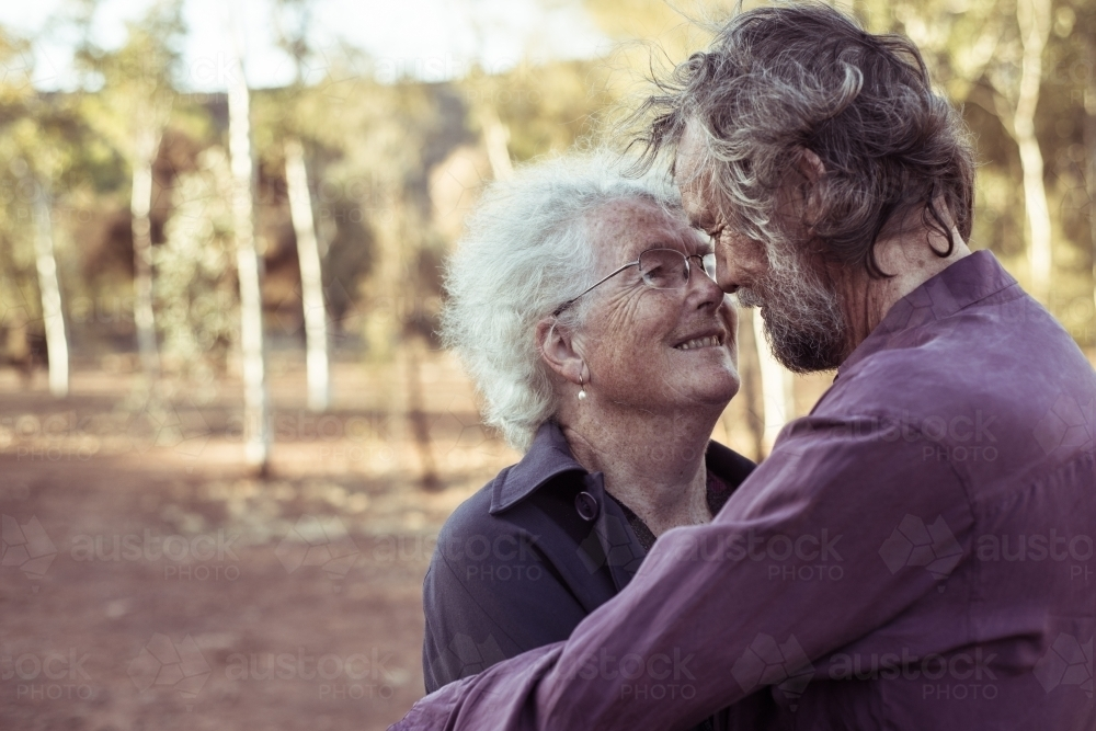 Happy elderly couple kiss in the Northern Territory - Australian Stock Image