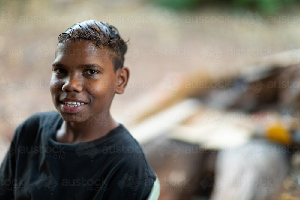 head and shoulders view of smiling teen boy in black t-shirt - Australian Stock Image