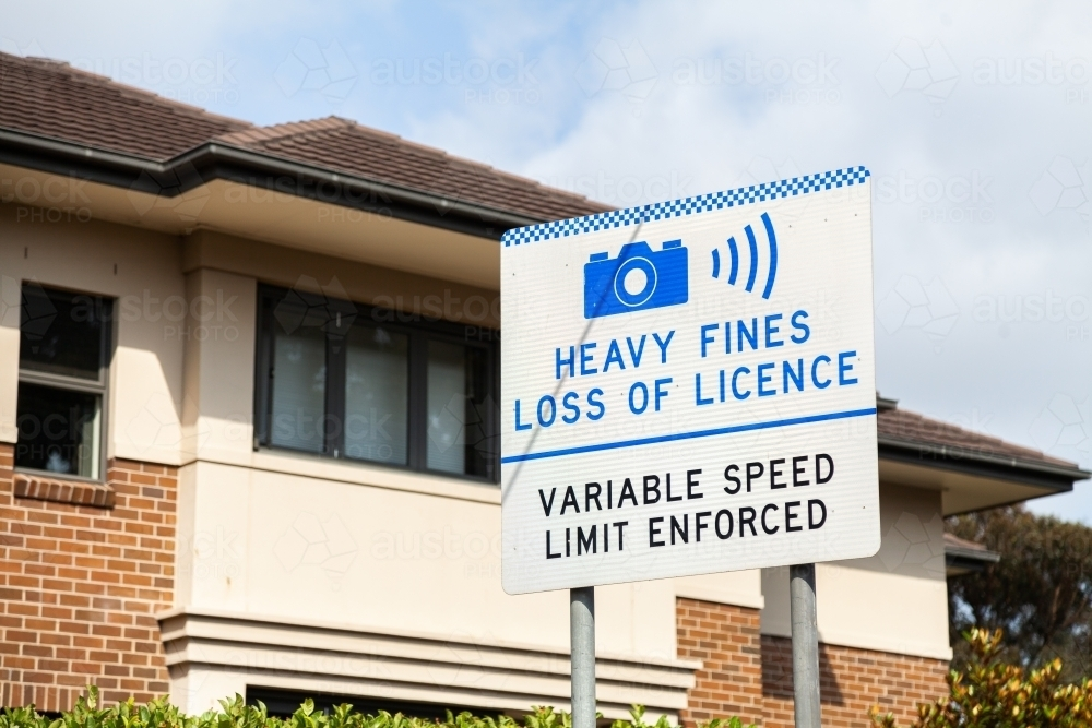 Heavy fines, loss of licence. Variable speed limit enforced sign - Australian Stock Image