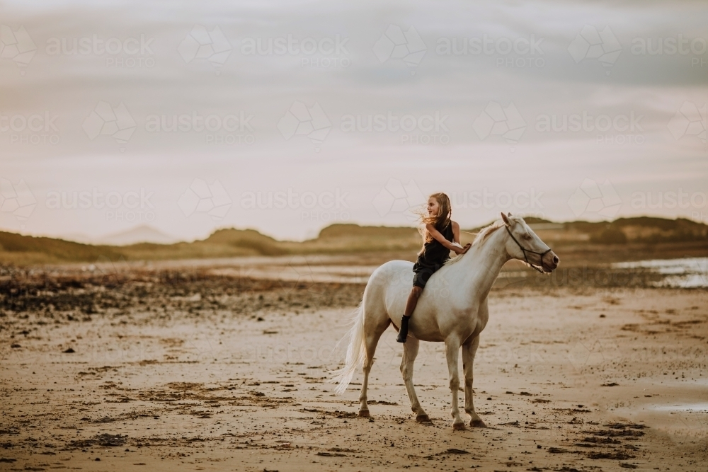 Horse riding on beach - Australian Stock Image