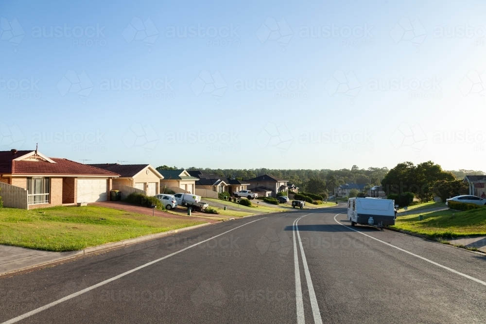 Houses along quiet Aussie suburban street in the morning light - Australian Stock Image