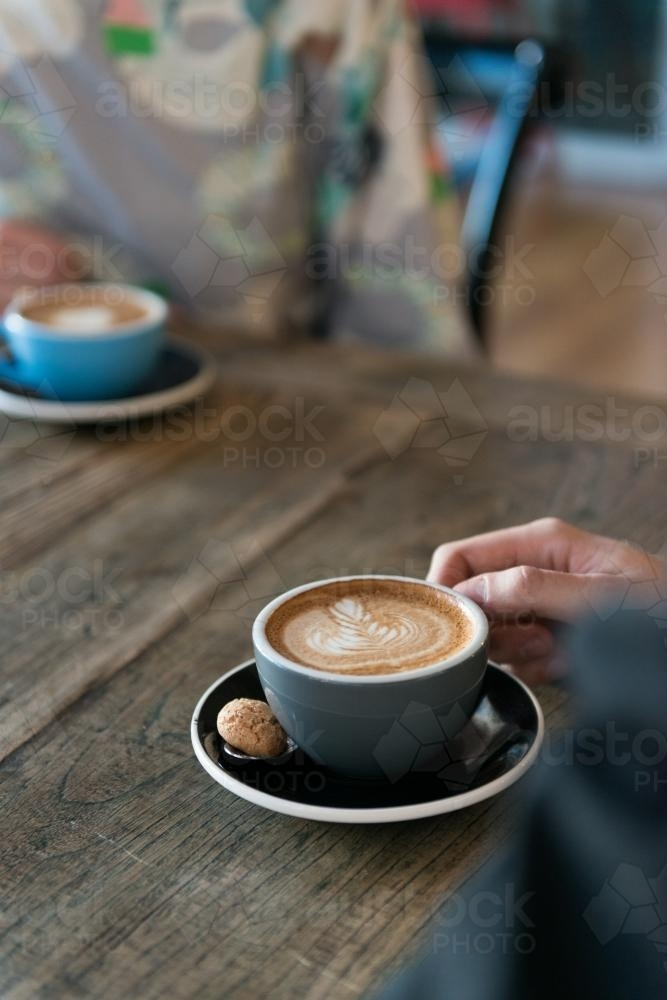 Image of a coffee on a wooden table - Australian Stock Image