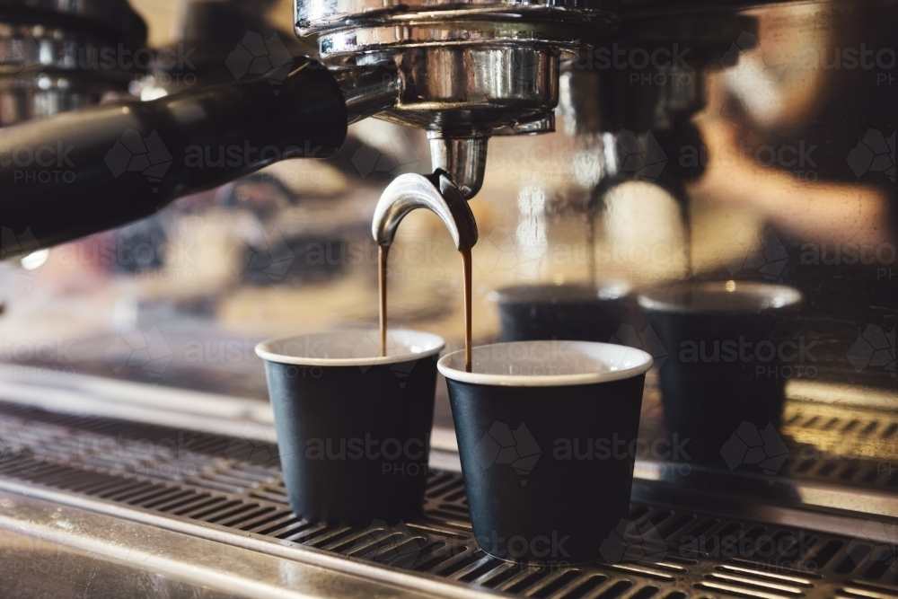 Industrial coffee machine making two cups of espresso - Australian Stock Image