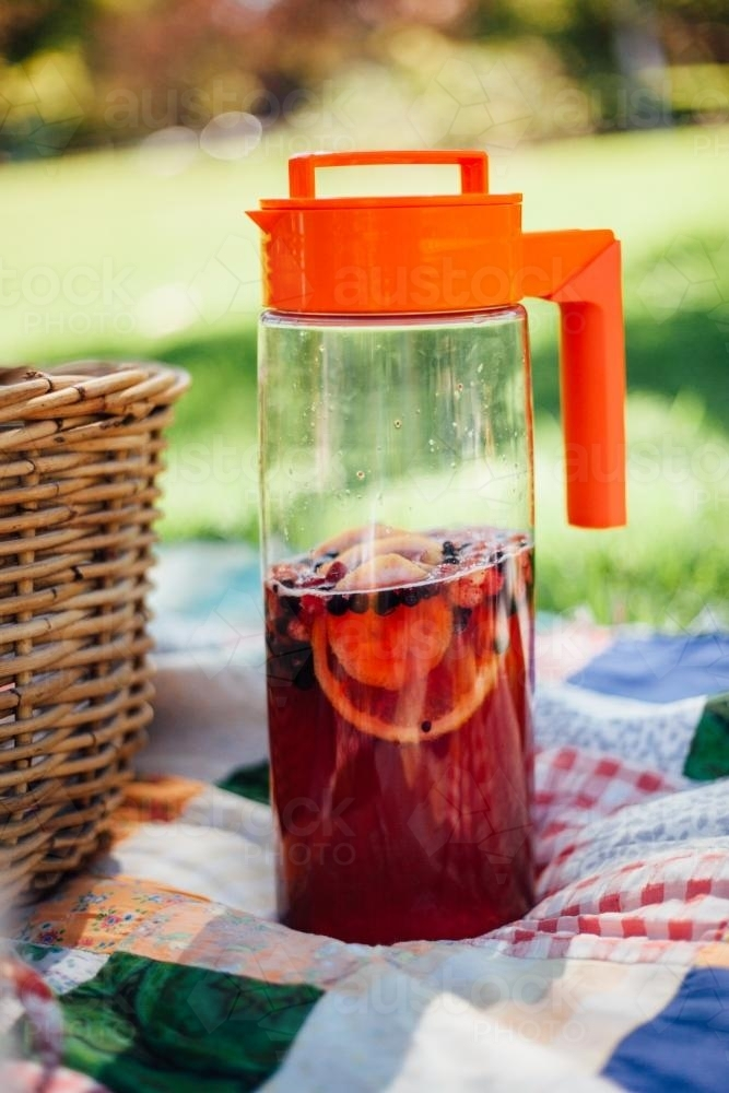 Jug of punch on picnic blanket - Australian Stock Image