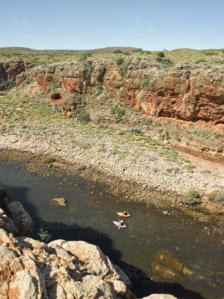 kayakers in remote gorge - Australian Stock Image