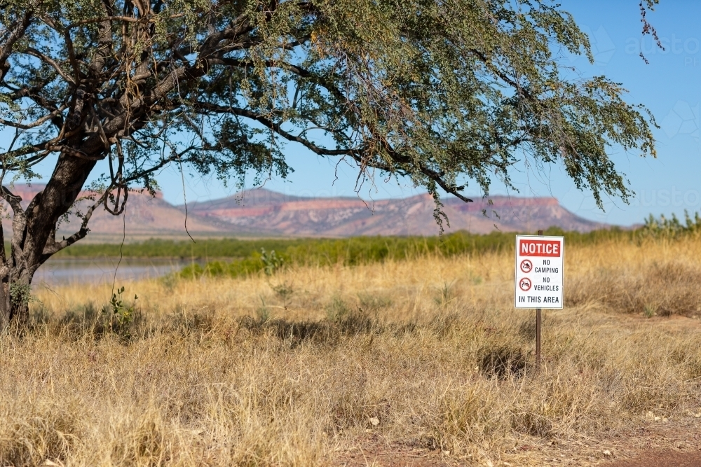 Kimberley landscape with sign advising no camping and no vehicles - Australian Stock Image