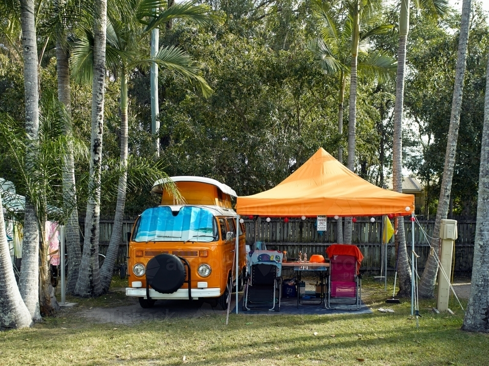Kombi van and shelter in tropical campground - Australian Stock Image