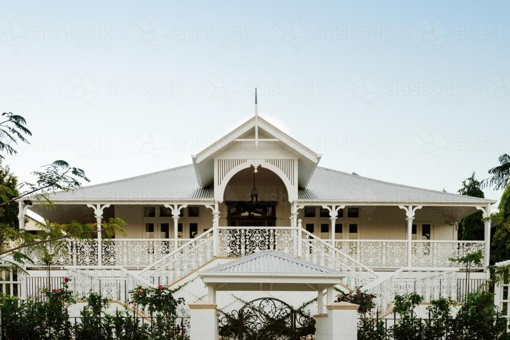 Large queenslander home with butterfly stairs - Australian Stock Image