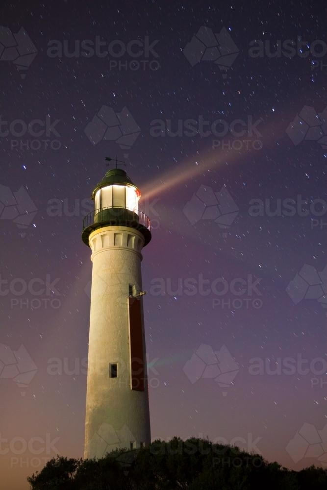 Light beams from a lighthouse at night - Australian Stock Image
