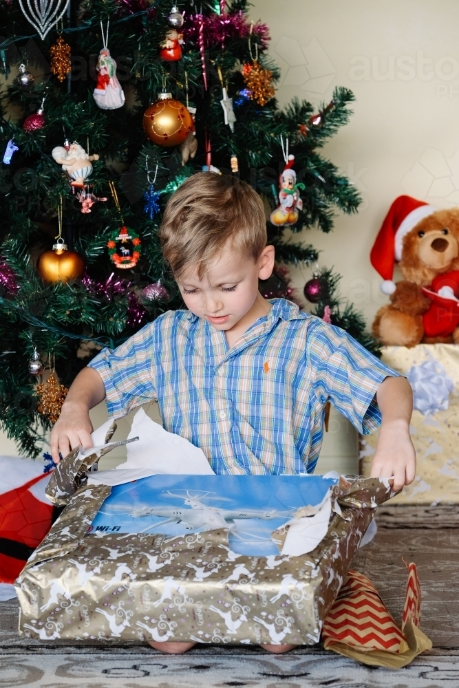 Little boy opening a drone on Christmas day - Australian Stock Image
