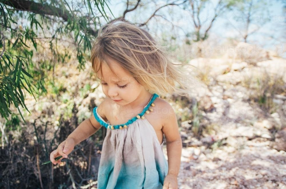 Little girl playing in the bush - Australian Stock Image