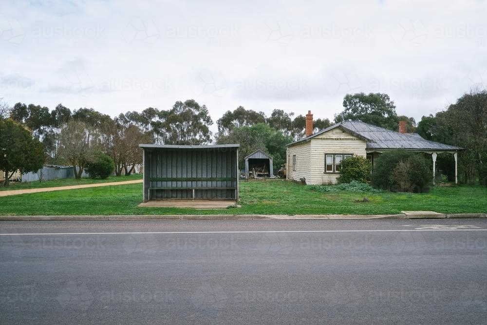 Local bus stop beside a house in regional township - Australian Stock Image