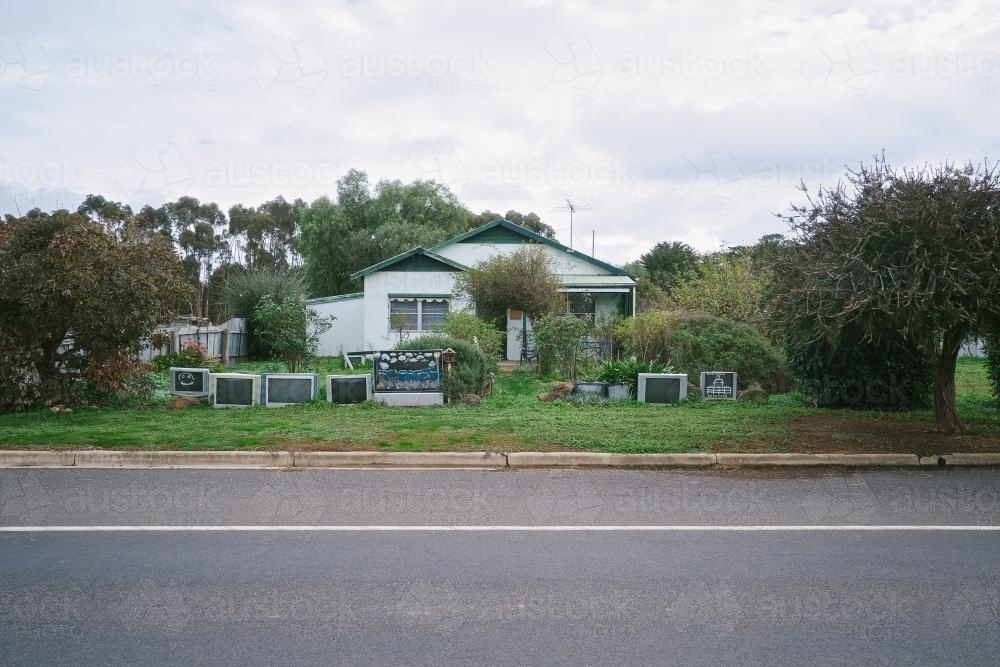 Local house in country town with a TV fence - Australian Stock Image