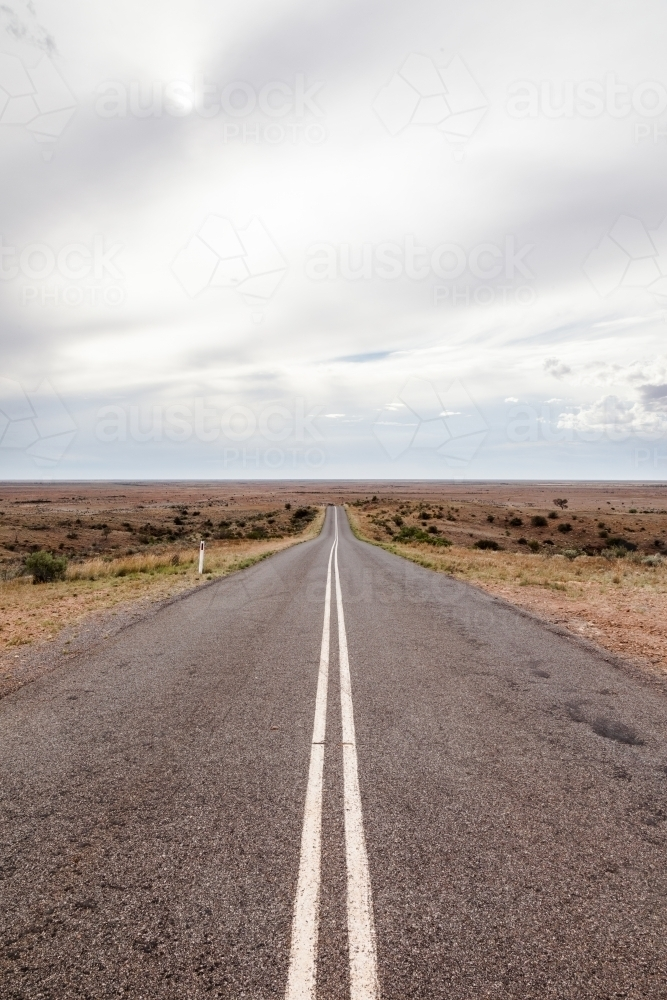Long straight road with double unbroken lines till the horizon - Australian Stock Image