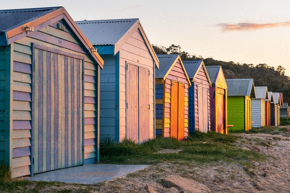 Looking along a row of colorful timber bathing boxes - Australian Stock Image