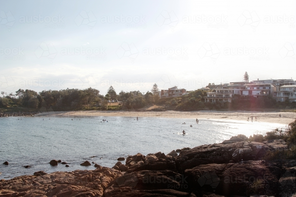Looking back at beach from rocky shoreline - Australian Stock Image