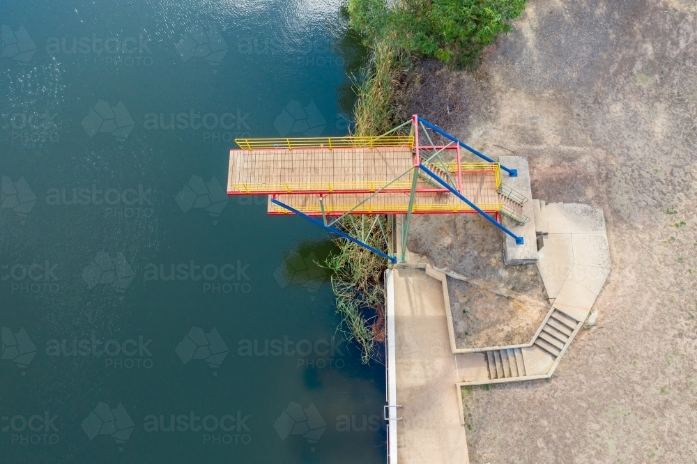 Looking down on a double level diving platform over a lake - Australian Stock Image