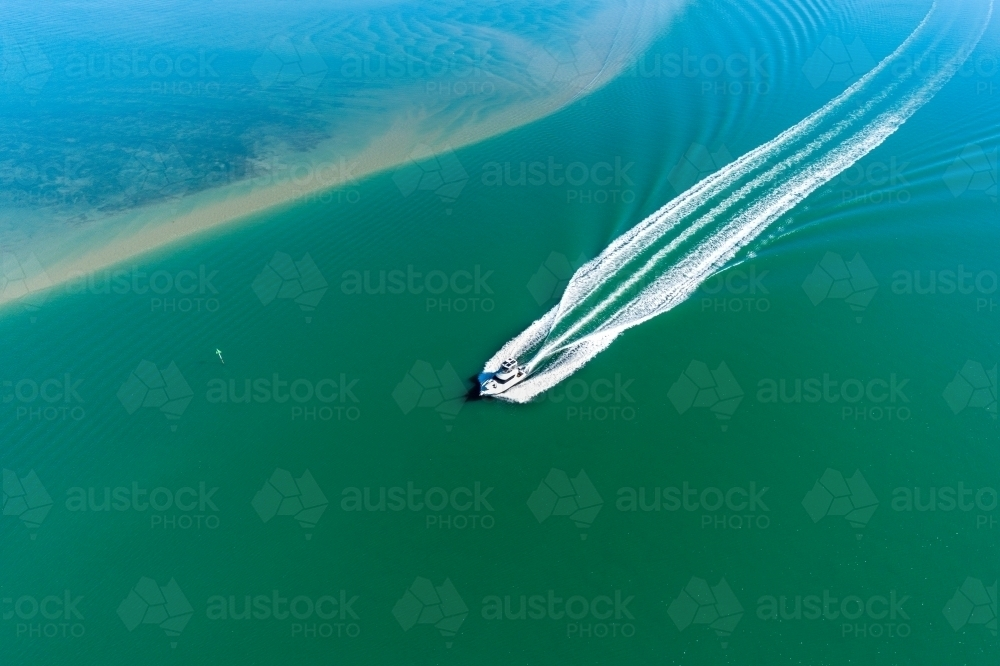 Looking down on a powerboat in estuary. - Australian Stock Image