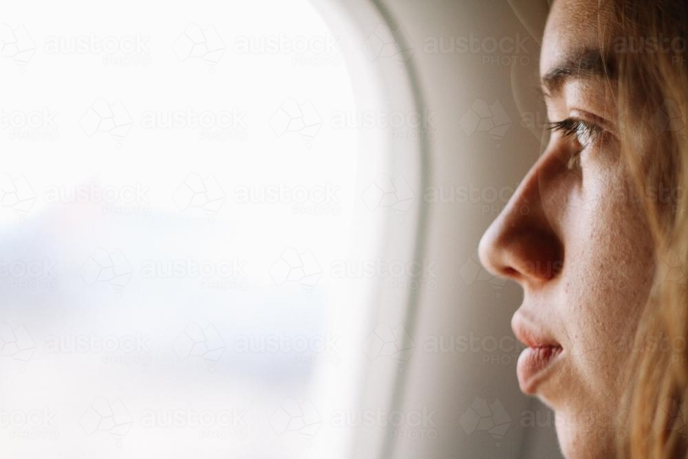 Looking out of airplane window - Australian Stock Image