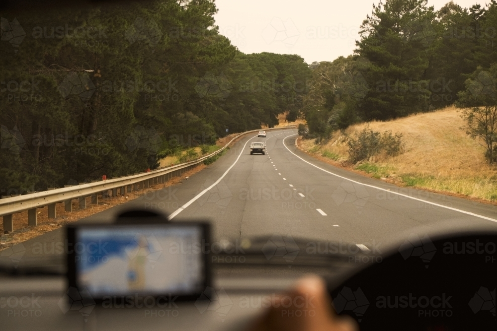 Looking through car front window on a road trip - Australian Stock Image