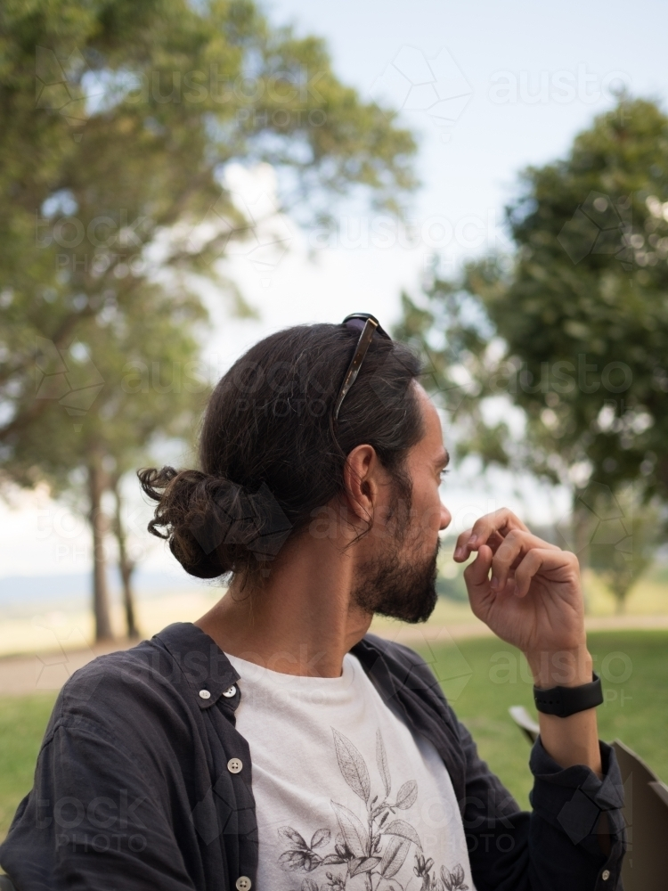 Man deep in thought surrounded by nature - Australian Stock Image