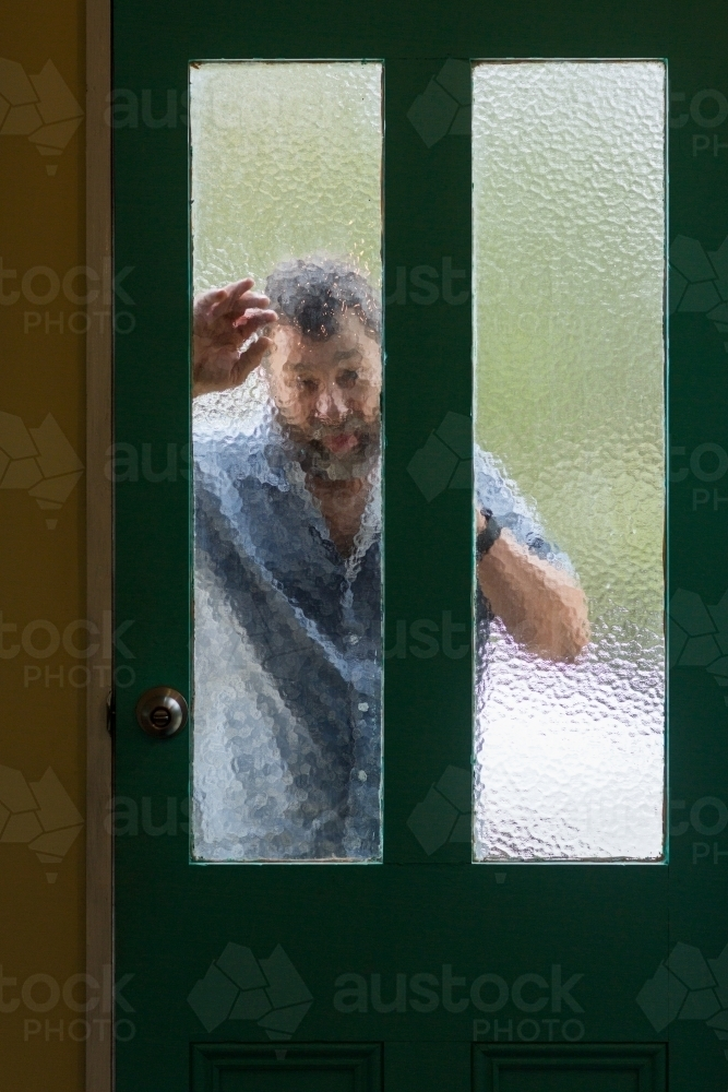 Image Of Man Looking In Through Frosted Glass Door Austockphoto
