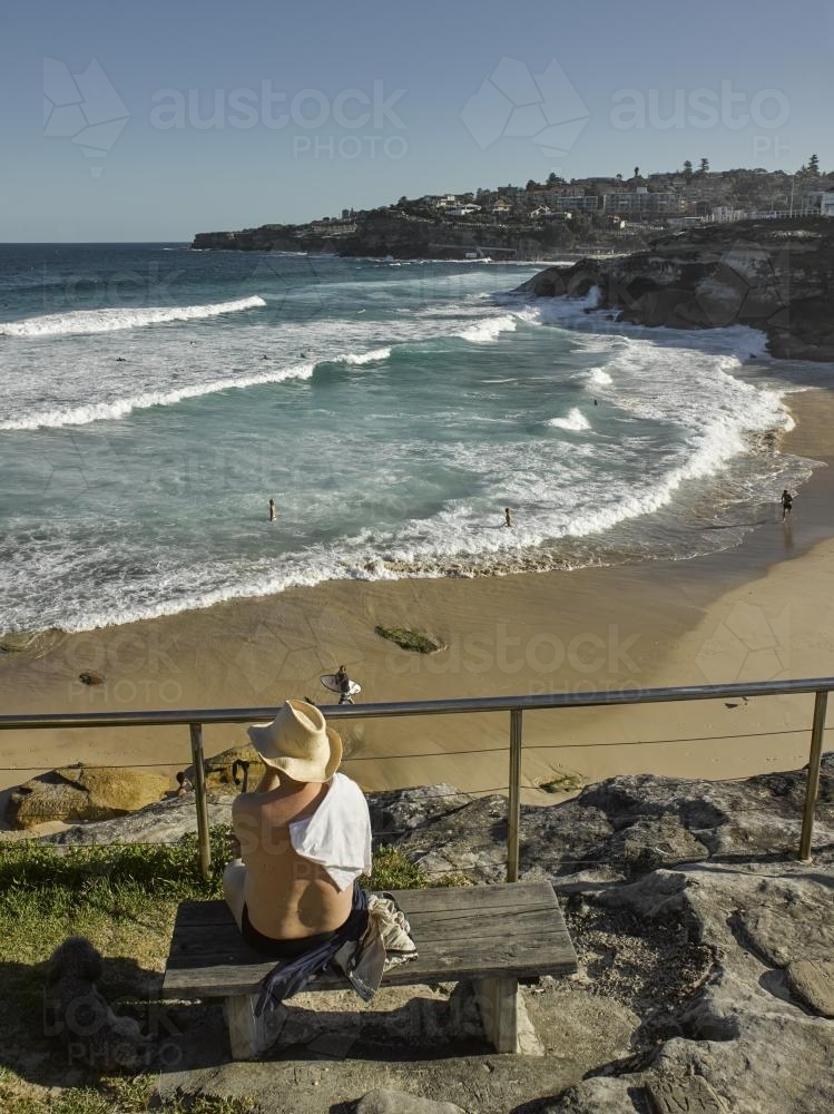 man looking out over Tamarama Beach - Australian Stock Image