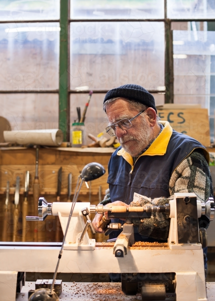 Man working with a lathe at a men's shed - Australian Stock Image