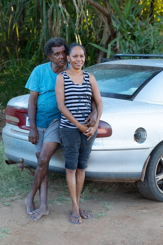 mature couple leaning against their car - Australian Stock Image