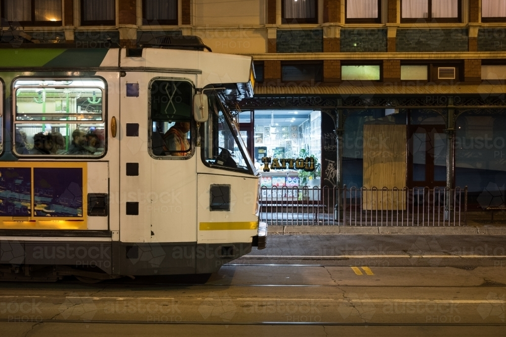Melbourne tram at night in city - Australian Stock Image