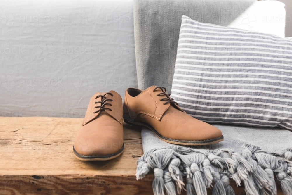 Mens Dress Shoes on Rustic Table - Australian Stock Image