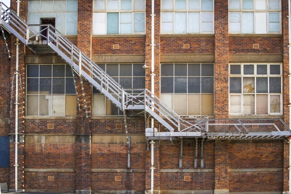 Metal stairs up the side of a historic factory in Launceston - Australian Stock Image